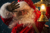 Santa Claus holding sack with gifts — Stock Photo