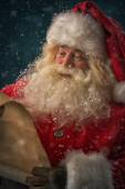 Santa Claus reading Christmas letter — Stock Photo