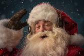 Santa Claus is listening music — Stock Photo