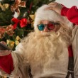 Santa Claus sitting near Christmas Tree — Stock Photo #53761149