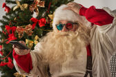 Santa Claus sitting near Christmas Tree — Stock Photo