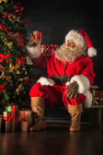 Santa is placing gift boxes — Stock Photo