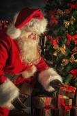 Santa is placing gift boxes — ストック写真