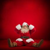 Santa Claus sitting on floor — Stockfoto