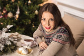 Woman drinking tea on  Christmas — Stock Photo