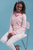 African woman sitting on   chair — ストック写真