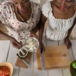 Two african women cooking salad — Stock Photo #65007943