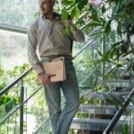 Businessman holding documents — Stock Photo #66232519