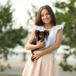 Woman holding small dog — Stock Photo #66235109