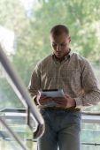 Businessman holding digital tablet — Stock Photo