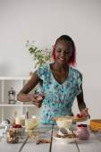 African woman cooking cake — Stock Photo