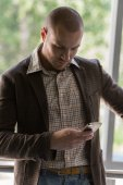 Businessman texting on the phone — Stock Photo