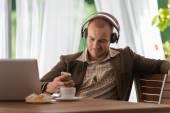 Businessman listening music with headphones — Stock Photo