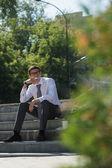 Well dressed businessman smoking — Foto Stock