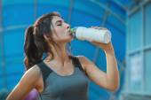 Fitness woman drinking water — Stock Photo