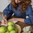 Woman writing in notepad — Stock Photo #70728821