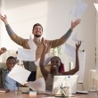Business people throwing up papers — Stock Photo #76747507