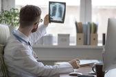 Doctor holding xray — Stock Photo