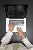 Working on laptop - from above — Stock Photo