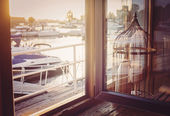 Windowview on the pier and yachts. — Stock Photo