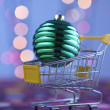 Shopping cart with christmas  ball — Stock Photo #65068457