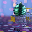 Shopping cart with christmas  ball — Stock Photo #65068507