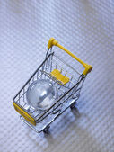 Glass globe on shopping cart. — Photo