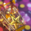 Christmas star in shopping cart — Stock Photo #65070629