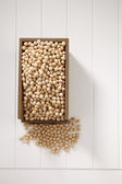 Soy bean in a wooden container — Stock Photo