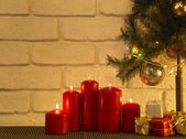 Candles and christmas tree — Stock Photo