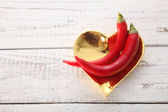 Red chili on the golden heart — Stock Photo