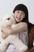 Girl hugging teddy bear — Stock Photo