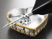 Rings,pen and heart shape box — Stock Photo