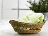 Hand towel in the basket — Stock Photo