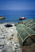 Wooden fishing boats and fish traps ashore — Stock Photo