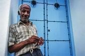 Tunisian man in front of door — Stock Photo