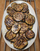 Grilled eggplants on wooden table — Stock Photo