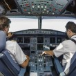 Two pilots in cockpit — Stock Photo #60331359
