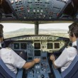 Two pilots in cockpit — Stock Photo #60331391