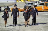 Flight assistants near an airplane — Stock Photo