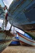 Old wooden fishing boats ashore — Stock Photo
