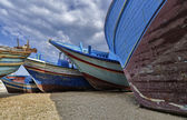 Old wooden fishing boats ashore — Stock Photo