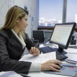 Business woman working in her office — Stock Photo #68702907