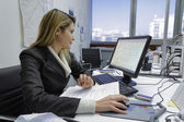 Business woman working in her office — Stock Photo