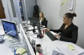 Business women working in an office — Stock Photo