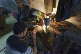 Indian people working in a jewelry factory — Stockfoto