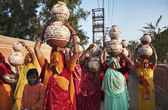 Indian women taking food to a wedding — Stock Photo