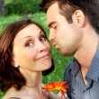 Cute couple kissing in the park — Stock Photo #84281844