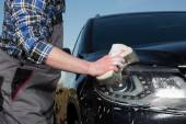 Car floodlight cleaning — Stock Photo