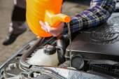 Filling the car water cooling system with fresh water — Stock Photo
